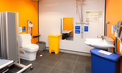 Changing Places toilet with orange walls