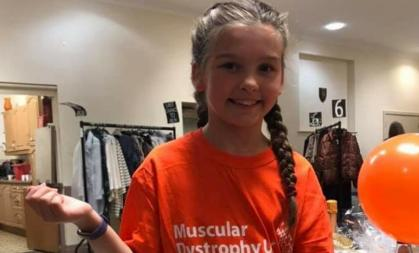 Young girl in orange top