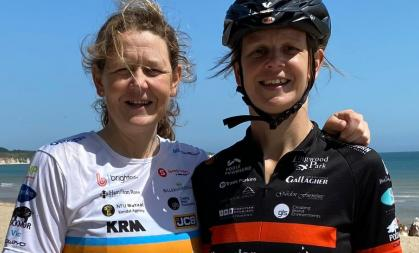 Two sisters dressed in cycling gear fundraising for Muscular Dystrophy UK