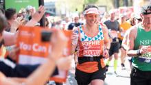 Sophie, a member of #TeamOrange running the London Marathon in 2018