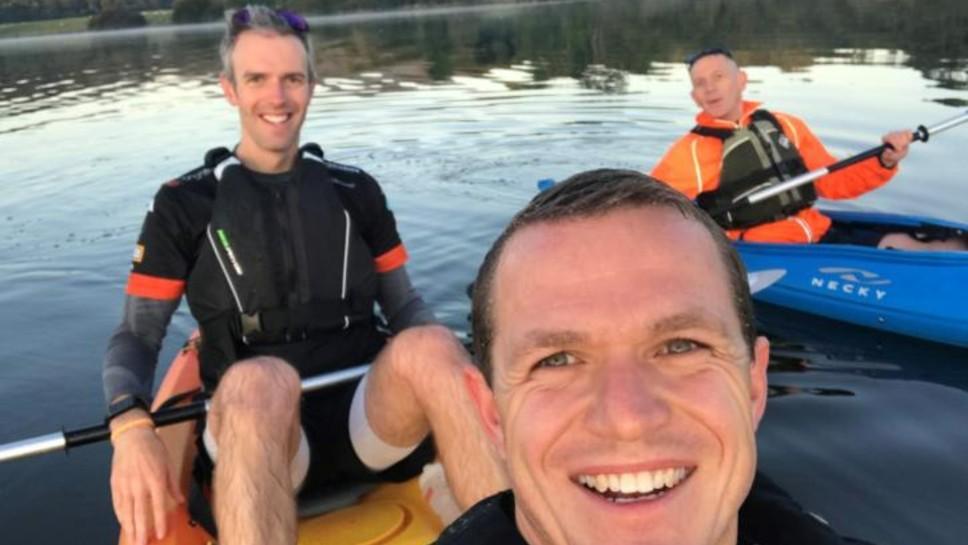 Three men on canoes